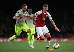 FC Koln's Marco Hoger (left) and Arsenal's Rob Holding during the Europa League match at the Emirates Stadium, London.