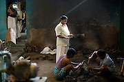 Radakrishna Stpathy directs the breaking open of a icon mould at his workshop in Swamimalai, India.The current Stpathy family is the twenty third generation of bronze casters dating back to the founding of the Chola Empire. The Stapathys had been sculptors of stone idols at the time of Rajaraja 1 (AD985-1014) but were called to Tanjore to learn bronze casting. Their methods using the ,?Úlost wax,?Ù process remains unchanged to this day..