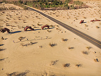 Aerial view of friends at Dragon sculpture in californian desert in Borrego Springs, USA.