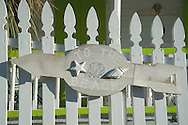 A sign to the beach on a picket fence in Dunmore Town, Harbour Island, Eleuthera, The Bahamas