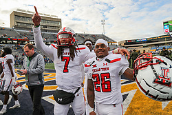 Nov 9, 2019; Morgantown, WV, USA; Texas Tech Red Raiders quarterback Jett Duffey (7) and Texas Tech Red Raiders running back Ta'Zhawn Henry (26) celebrates with fans after beating the West Virginia Mountaineers at Mountaineer Field at Milan Puskar Stadium. Mandatory Credit: Ben Queen-USA TODAY Sports