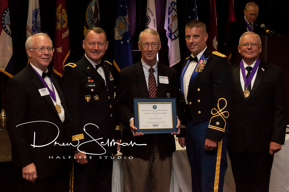 """Dr. Jerry Davis (c.) and Lt. Col. James Schreffler (c.r.) receive the """"Above and Beyond Award"""" on behalf of College of the Ozarks from Rear. Adm. (Ret.) Lee Metcalf (l.), MO ESGR State Chair, Brig. Gen. Martin Robinson (c.l.), Assistant Adjutant General Support for Missouri National Guard and Maj. Gen. (Ret.) Paul E. Mock (r.), National Chair for ESGR at the MO ESGR 2014 Annual Awards Dinner in Jefferson City on August 8, 2014.  ESGR, a DOD office, works employers to support and value the employment of National Guard and Reserve military. (MO ESGR / Drew Selman)"""