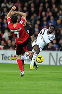 Swansea's Nathan Dyer has a shot blocked by Cardiff's Peter Whittingham. Barclays Premier League match, Cardiff city v Swansea city at the Cardiff city stadium in Cardiff, South Wales on Sunday 3rd Nov 2013. pic by Andrew Orchard, Andrew Orchard sports photography,