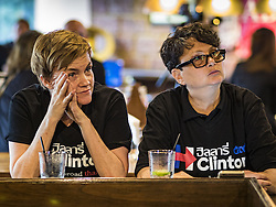 November 9, 2016 - Bangkok, Bangkok, Thailand - Women wearing Hillary Clinton / Democrats Abroad Thailand tee shirts watch election results come in Wednesday morning (Thai time) in Bangkok. Democrats Abroad Thailand met at the Roadhouse Barbecue, an American restaurant in Bangkok, to watch election results come in. It was a somber election watch party as what was expected to be a Clinton victory turned into a Trump win. (Credit Image: © Jack Kurtz via ZUMA Wire)
