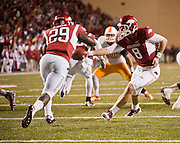 Nov 12, 2011; Fayetteville, AR, USA;  Arkansas Razorbacks quarterback Tyler Wilson (8) hands the ball to running back Broderick Green (29) during a game against the Tennessee Volunteers at Donald W. Reynolds Razorback Stadium. Arkansas defeated Tennessee 49-7. Mandatory Credit: Beth Hall-US PRESSWIRE