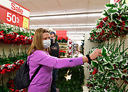 Chrissy Botkin and her husband Tim Botkin of Belleville look for Christmas garland and wreaths to decorate their house while shopping at Ben's store in downtown Belleville on Friday November 27, 2020. <br /> Photo by Tim Vizer