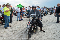 John Landstrom riding his 1928 BMW R62 as he passes through the start on the sands of Daytona Beach at the beginning of stage 1 of the Motorcycle Cannonball Cross-Country Endurance Run, which on this day ran from Daytona Beach to Lake City, FL., USA. Friday, September 5, 2014.  Photography ©2014 Michael Lichter.