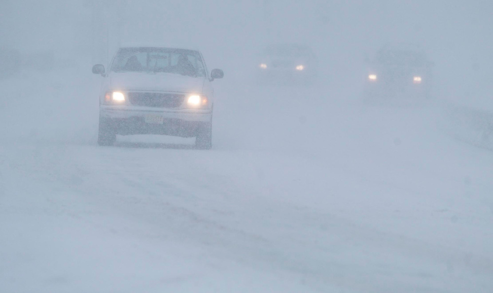 (PPAGE1) Union Beach 12/6/2003  White out conditions occured on Hwy 36 in Union Beach near Holy Family Roman Catholic Church.   Michael J. Treola Staff Photographer......MJT