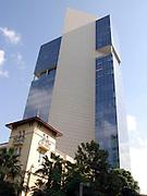 Israel, Tel Aviv, New buildings over powering an old building