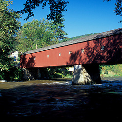 West Cornwall, CT. A covered bridge spans The Housatonic River in the Litchfield Hills of western Connecticut.