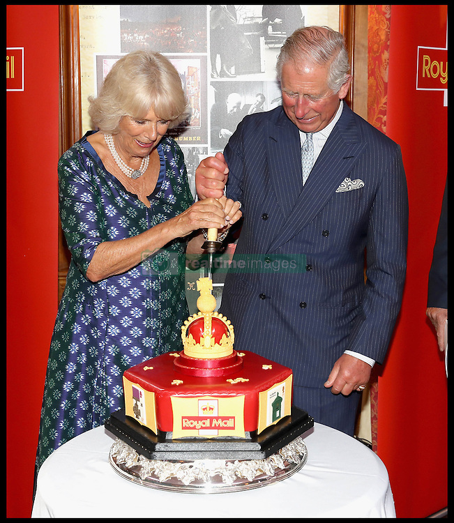 Image ©Licensed to i-Images Picture Agency. 06/09/2016. London, United Kingdom. Royal Mail  500th Anniversary. <br /> <br /> Prince Charles, Prince of Wales and Camilla, Duchess of Cornwall cut into a celebratory Royal Mail 500 Cake as they attend a reception to mark the 500th Anniversary of the Royal Mail at Merchant Taylor's Hall on September 6, 2016 in London, England<br /> <br /> Picture by  i-Images / Pool