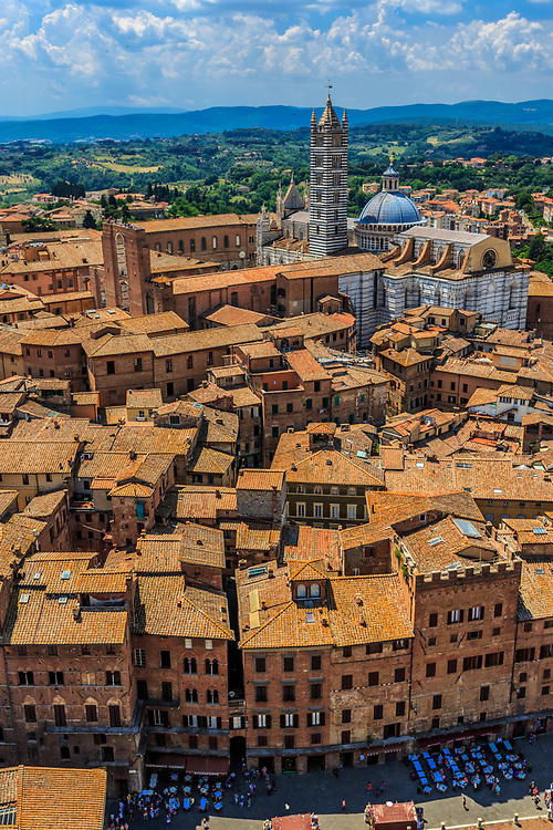 A scenery from Torre del Mangia towards Siena Cathedral in Siena, Italy. The cathedral itself was originally designed and completed between 1215 and 1263 on the site of an earlier structure.