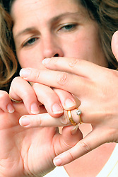 Married woman aged 40 pulling off her wedding ring UK