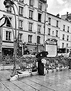 Paris during Covid 19 pandemic. pedestrians with covid mask in  Belleville market