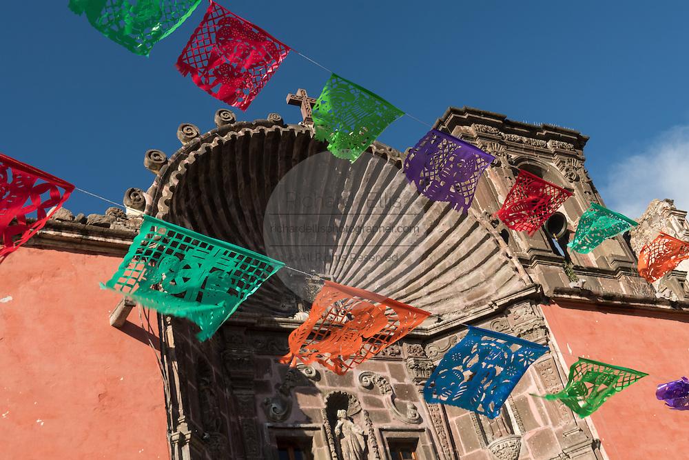 Paper banners decorate the Church of Our Lady of Health or  Nuestra Señora de la Salud Church in San Miguel de Allende, Guanajuato, Mexico.