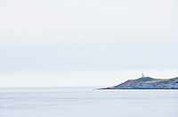 The Lighthouse Reservation on San Juan Island in the San Juan Island National Historical Park with the San Juan Channel in the foreground and the Strait of georgia behind.
