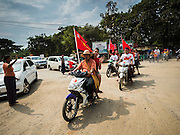 25 OCTOBER 2015 - SHWEPYITHAR, MYANMAR:  National League for Democracy (NLD) motorcyclists participate in a NLD motorcade in Shwepyithar, Myanmar. Political parties are in fill campaign mode in Myanmar (Burma). National elections are scheduled for Sunday Nov. 8. The two principal parties are the National League for Democracy (NLD), the party of democracy icon and Nobel Peace Prize winner Aung San Suu Kyi, and the ruling Union Solidarity and Development Party (USDP), led by incumbent President Thein Sein. There are more than 30 parties campaigning for national and local offices.    PHOTO BY JACK KURTZ