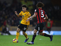 Wolverhampton Wanderers' Morgan Gibbs-White (left) and Bournemouth's Nathan Ake battle for the ball