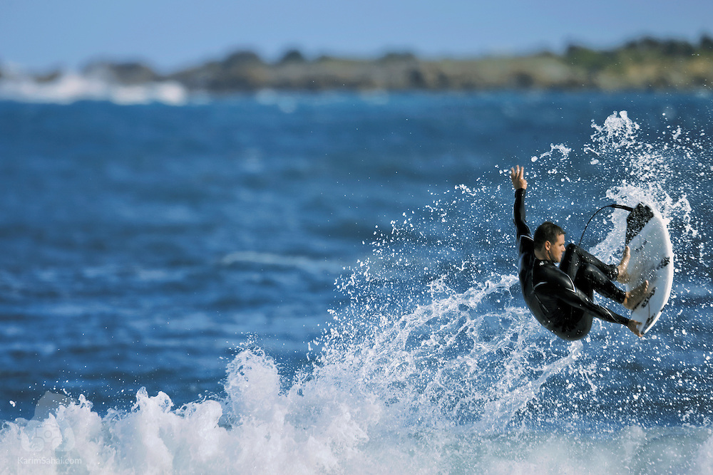 A surfer leaps from a wave at Lyall Bay, Wellington, New Zealand.