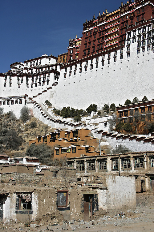 The Potala palace was former home to Dalai Lama, this picture is a juxtaposition between the palace above and the ruin below in Lhasa, Tibet