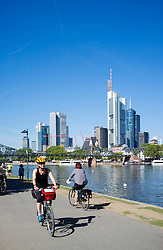 Skyline of financial district of Frankfurt and riverside park in summer Germany