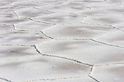 Geometrical salt patterns cover the otherwise flat ground of the Salinas Grandes salt flats, northern Argentina.