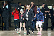 Mourners leave the first memorial service for a child killed by the tornado that struck Plaza Towers elementary school in Oklahoma City, May 23, 2013. Nine-year-old Antonia Candelaria, died along with six other children in the school in the tornado May 20, 2013.    REUTERS/Rick Wilking (UNITED STATES)