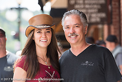 Olivia with her dad Scott Jacobs outside the Scott Jacobs Gallery where they work on Main Street in Deadwood during the annual Sturgis Black Hills Motorcycle Rally. Deadwood, SD, USA. Monday August 7, 2017.  Photography ©2017 Michael Lichter.