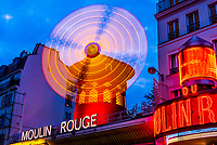 Moulin Rouge (French for Red Windmill) is a tourist attraction in Pigalle on Boulevard de Clichy, 18th arrondissement. It is best known as the birthplace of the modern form of the can-can dance. Paris, France.