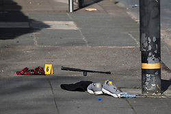 © Licensed to London News Pictures . 25/03/2018 . Manchester , UK . Police close off a section of Upper Chorlton Road in Chorlton-cum-Hardy after a man armed with a sword was detained . Clothes , used Tasers and a police baton lie scattered on the road and pavement following a reported struggle with a man , who was tasered at the scene . Photo credit : Joel Goodman/LNP