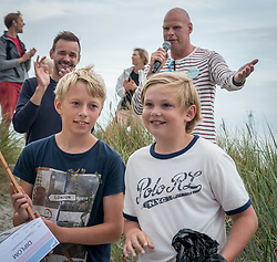 July 30, 2017 - Falsterbo, Sweden - Falsterbo, Sweden. 30th July, 2017. Since 1983 a sand sculpture competition has been held annually the last Sunday in July at the South West tip of the Swedish coast. Winners of the first prize for children, Flygande bananerna,  receiving their award. (Credit Image: © Tommy Lindholm/Pacific Press via ZUMA Wire)