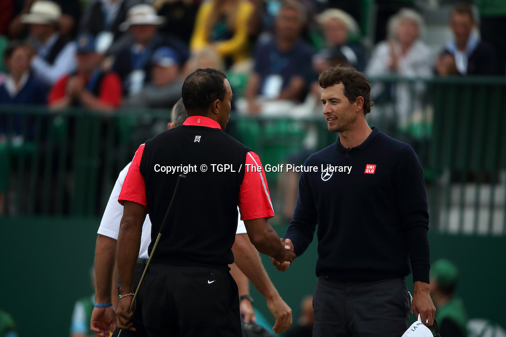 Tiger WOODS (USA) and Adam SCOTT (AUS) shake hands at 18th during fourth round Open Championship 2013,Muirfield,Gullane,East Lothian,Scotland.