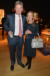 DAVID TREDINNICK MP and his wife REBECCA at a party to celebrate the publication of Interiors For Living by Joanna Wood held at Christie's. 8 King Street, St.James's, London on 2nd March 2015.