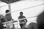 Ali vs Lewis Fight, Croke Park,Dublin.<br /> 1972.<br /> 19.07.1972.<br /> 07.19.1972.<br /> 19th July 1972.<br /> As part of his built up for a World Championship attempt against the current champion, 'Smokin' Joe Frazier,Muhammad Ali fought Al 'Blue' Lewis at Croke Park,Dublin,Ireland. Muhammad Ali won the fight with a TKO when the fight was stopped in the eleventh round.<br /> <br /> Picture shows Lewis missing with a wild right as Ali steps aside.
