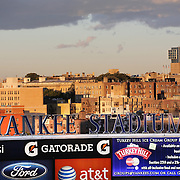 The Yankee Stadium sign in Yankee Stadium as the evening sunshine catches surrounding buildings during  the New York Yankees V Baltimore Orioles American League Division Series play-off decider at Yankee Stadium, The Bronx, New York. 12th October 2012. Photo Tim Clayton