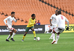 South Africa: Johannesburg: Bafana Bafana player Percy Tau battle for the ball with Seychelles players Karl Hopprich(L) and Colin Bibi(R) during the Africa Cup Of Nations qualifiers at FNB stadium, Gauteng.<br />Picture: Itumeleng English/African News Agency (ANA)
