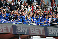 AFC Wimbledon defender Barry Fuller (2) trophy lift celebrates promotion to Sky Bet League 1 at the end of during the Sky Bet League 2 play off final match between AFC Wimbledon and Plymouth Argyle at Wembley Stadium, London, England on 30 May 2016.