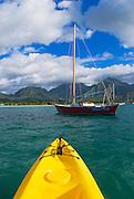 Kayak and sail boat on Hanalei Bay, North Shore, Island of Kauai, Hawaii