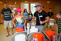 "Lucie and ""Mr. Rich"" join together for a freestyle drum set during ""Youth Beatz"" with Lakes Region Child Services at Leavitt Park Tuesday evening.  (Karen Bobotas/for the Laconia Daily Sun)"