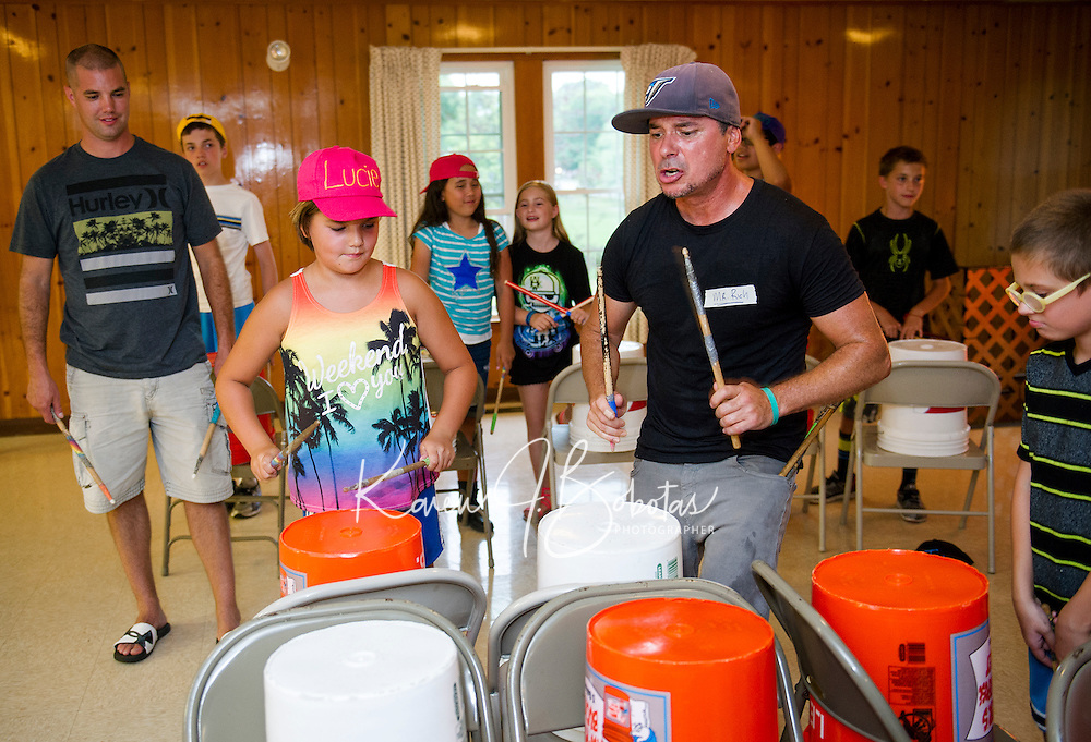 """Lucie and """"Mr. Rich"""" join together for a freestyle drum set during """"Youth Beatz"""" with Lakes Region Child Services at Leavitt Park Tuesday evening.  (Karen Bobotas/for the Laconia Daily Sun)"""