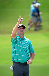 Grayson Murray checks the direction of the wind by tossing grass blades into the air prior to hitting from a sand trap  along the 18th fairway during first round action of the PGA Championship at Quail Hollow Club Thursday, Aug. 10, 2017 in Charlotte, N.C. (Photo by Jeff Siner/Charlotte Observer/TNS/Sipa USA)  *** Please Use Credit from Credit Field ***