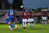 AFC Wimbledon defender Rod McDonald (26) with a header during the EFL Carabao Cup 2nd round match between AFC Wimbledon and West Ham United at the Cherry Red Records Stadium, Kingston, England on 28 August 2018.