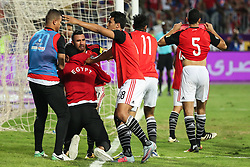 October 8, 2017 - Alexandria, Egypt - Egypt's team players celebrate wining against Congo's team during their World Cup 2018 Africa qualifying match between Egypt and Congo at the Borg el-Arab stadium in Alexandria on October 8, 2017. Liverpool striker Mohamed Salah converted a stoppage-time penalty to give Egypt a dramatic 2-1 win over Congo Brazzaville Sunday and a place at the 2018 World Cup in Russia. (Credit Image: © Ahmed Awaad/NurPhoto via ZUMA Press)