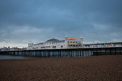 © Licensed to London News Pictures. 31/01/2015. Brighton, UK. Dark clouds hang over Brighton Pier on Saturday morning. A cold day in Brighton and the South Coast with temperatures expected to reach a maximum of 4C down the South Coast. Photo credit : Hugo Michiels/LNP