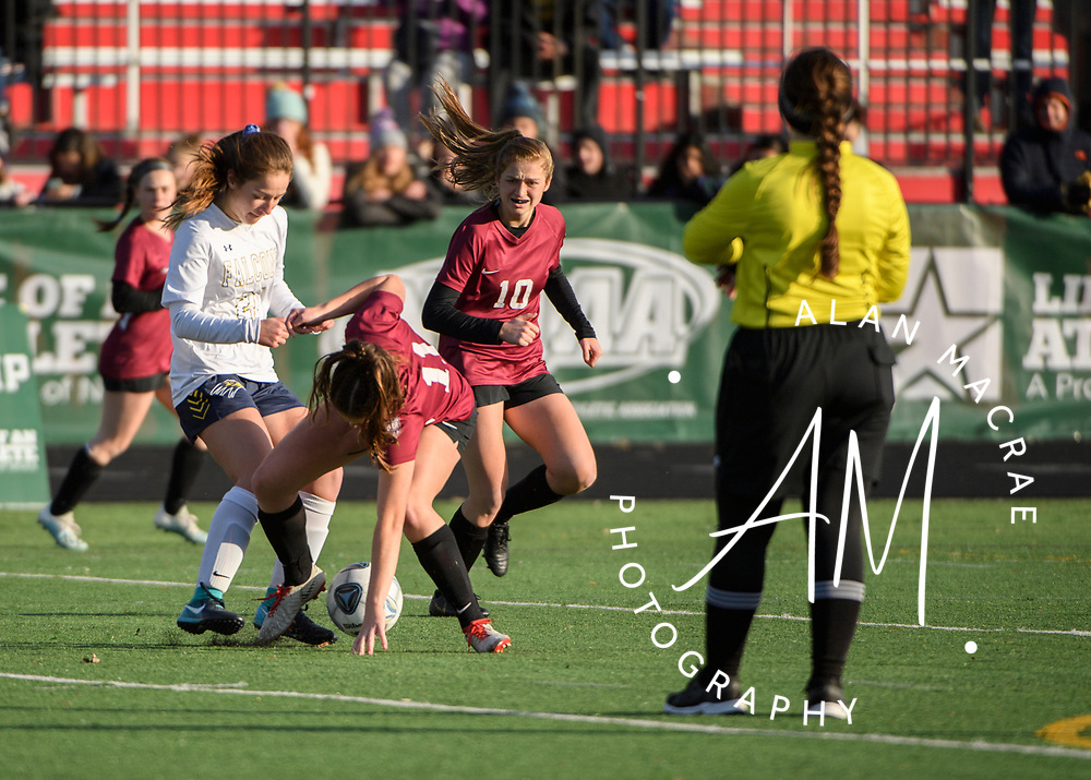 Hanover sophomore Carolyn Adams collides with Bow sophomore Madison Roberge during the NHIAA Division II soccer championship in Manchester on Sunday, November 10, 2019.  (Alan MacRae/Valley News)