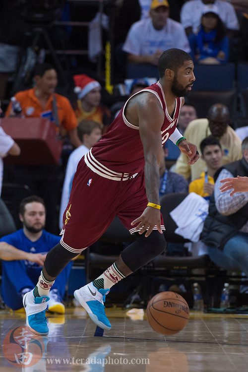 December 25, 2015; Oakland, CA, USA; Cleveland Cavaliers guard Kyrie Irving (2) dribbles the basketball during the third quarter in a NBA basketball game on Christmas against the Golden State Warriors at Oracle Arena. The Warriors defeated the Cavaliers 89-83.