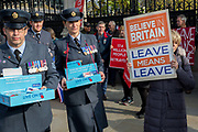 On the day that the UK was scheduled to leave the European Union and political parties commence campaigning for the General Election on 12th December, RAF military personnel sell poppies to Brexiters who are voicing their anger outside the British parliament in Westminster, on 31st October 2019, in London, England.