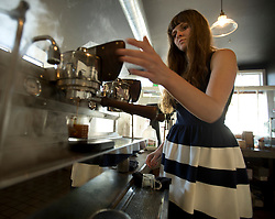 Barista Rachael Smith brews a shot of espresso at Devout Coffee, Tuesday, April 5, 2016, in Fremont, Calif. (Photo by D. Ross Cameron)