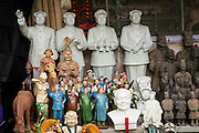 Cultural Revolution statues at Dongtai Lu antique market in Shanghai, China