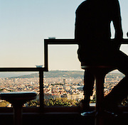 Cityscape view of Barcelona, including Montjuic opposite, from a cafe in Park Güell, Barcelona, Spain